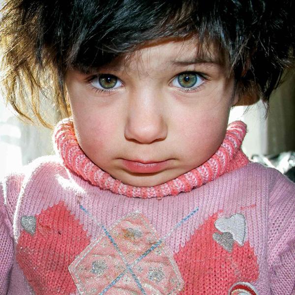 Child wearing a warm sweater.
