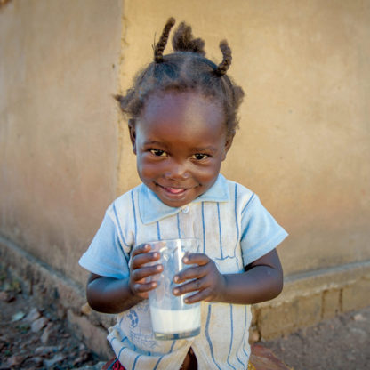 Child with a glass of milk.