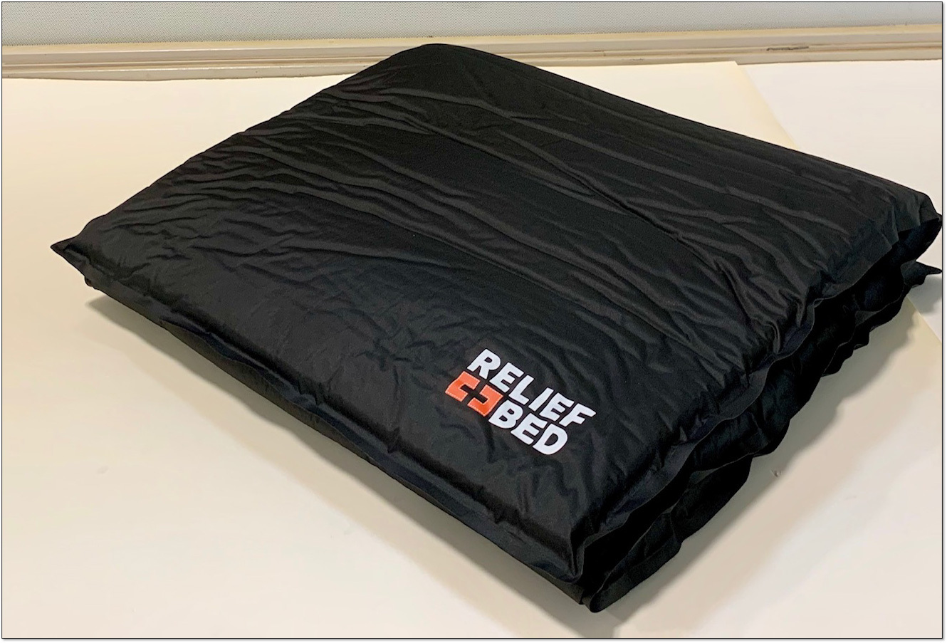 Relief Bed-- a portable, durable solution for those on the move or lacking a place to sleep.