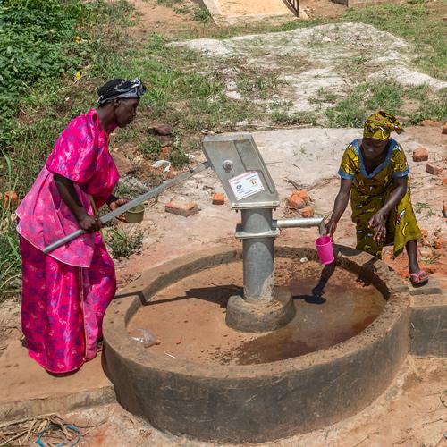 Women at water pump