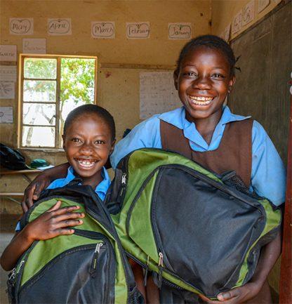 Children holding school supplies